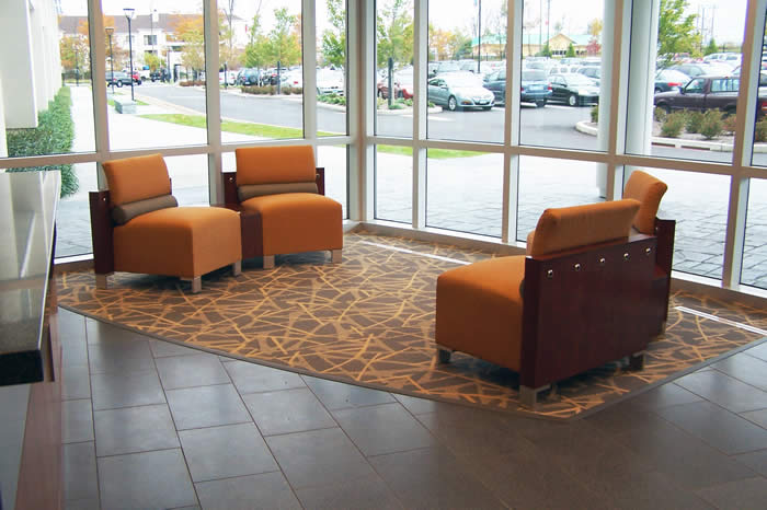 lobby design with carpet inset to create area rug