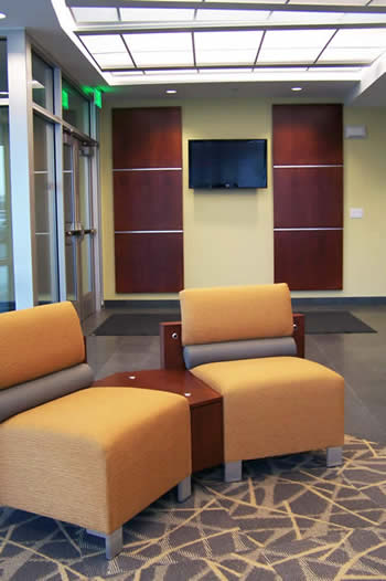 lobby with warm wood panels and Delano seating