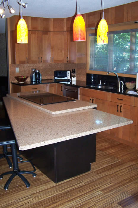 Green Kitchen with Natural Bamboo Floors, recycled counters and cork backsplash
