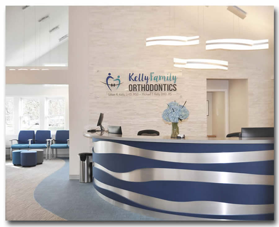Kelly Family Orthodontics Check in with cool lighting and stone wall