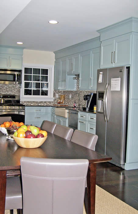 light blue cabinetry in staff kitchen