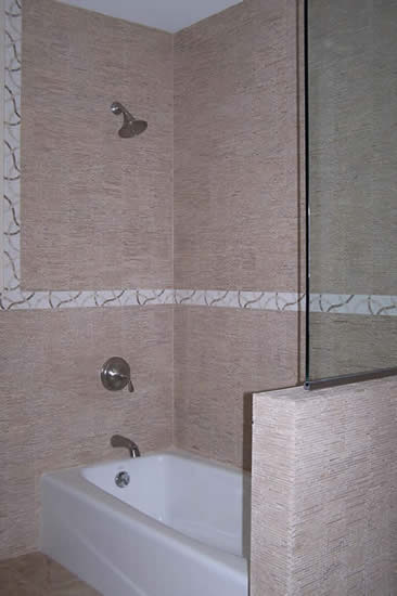 modern shower with tumbled stone mosaic