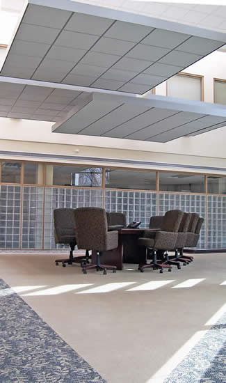suspended acoustical ceiling clouds over conference table
