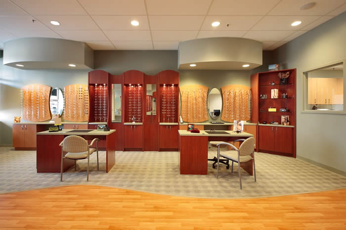 Tolland Eye Care cuvilinear optical center with wood look flooring