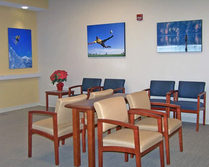 waiting room in orthopedic office with blue & golden textiles