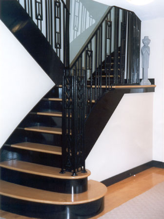 Nice FX Designed A Custom Staircase With Frank Lloyd Wright Style Iron Railings.  We Added Subtle Curves Into Three Bottom Stairs To Create An Inviting Feel.